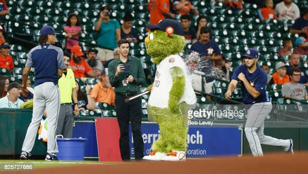 Houston Astros mascot Orbit is hit with a water balloon by Peter Bourjos of the Tampa Bay Rays as Chris Archer distracts him at Minute Maid Park on...