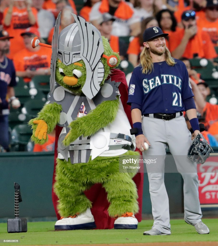 Houston Astros mascot Orbit plays with Taylor Motter #21 of the Seattle Mariners during super hero day at Minute Maid Park on September 16, 2017 in Houston, Texas.
