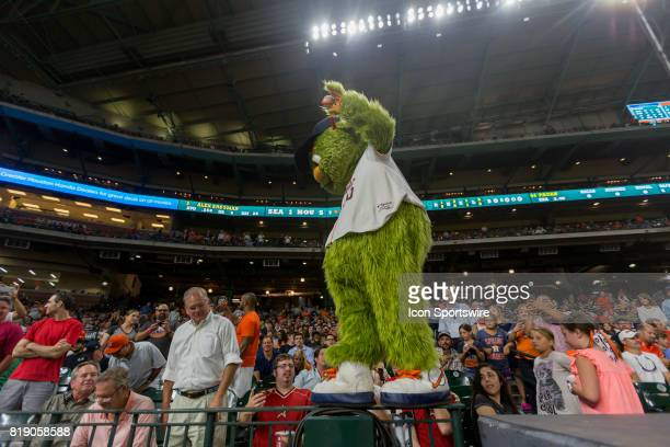 Houston Astros mascot Orbit walk on the rail to entertain the fans in the seventh inning during an MLB baseball game between the Houston Astros and...