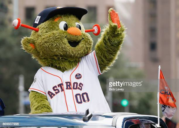 Houston Astros mascot Orbit waves to the crowd during the Houston Astros Victory Parade on November 3 2017 in Houston Texas The Astros defeated the...