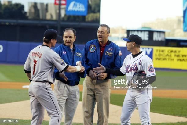 Houston Astros' outfielder Craig Biggio and New York Mets' pitcher Jon Franco greet NASA's Mark Polansky and Michael Massimino before the astronauts...