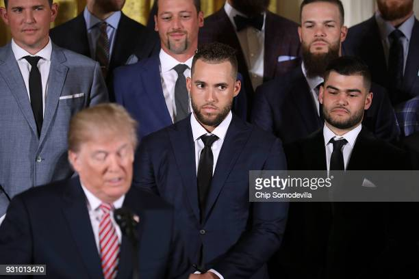 Houston Astros outfielder George Springer and pitcher Lance McCullers Jr watch US President Donald Trump delier remarks during a celebration of the...