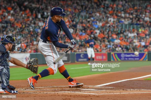 Houston Astros outfielder George Springer prepares to hit a hard shot to the shortstop during the baseball game between the Detroit Tigers and the...