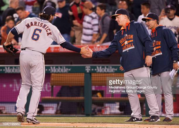 Houston Astros outfielder Jake Marisnick, a former Riverside Poly star, celebrates after the Astros' 3-2 victory Thursday night at Angel Stadium....