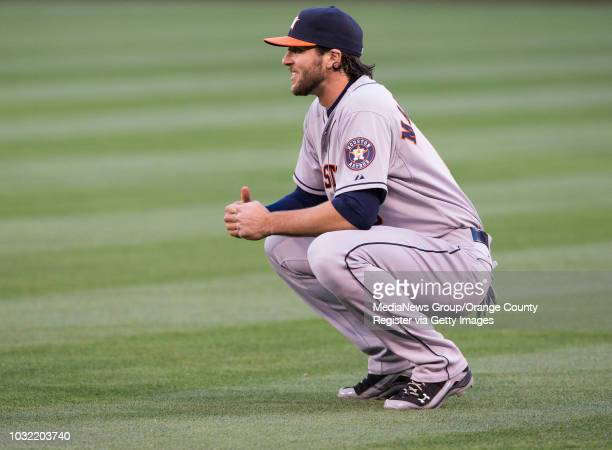 Houston Astros outfielder Jake Marisnick a former Riverside Poly star warms up before the start of the Astros game against the Halos Thursday night...