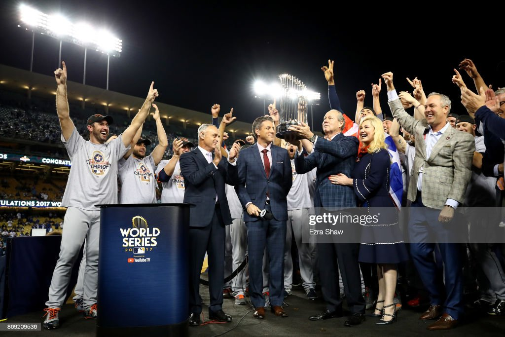 Houston Astros owner and chairman Jim Crane hoists the Commissioner's Trophy after the Astros defeated the Los Angeles Dodgers 5-1 in game seven to win the 2017 World Series at Dodger Stadium on November 1, 2017 in Los Angeles, California.
