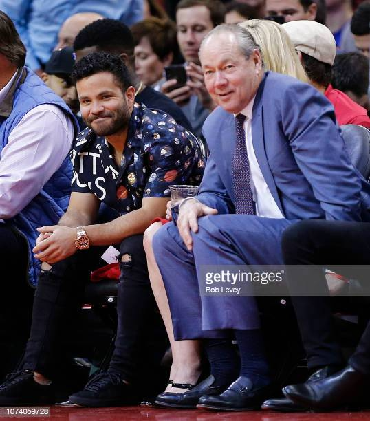 Houston Astros owner Jim Crane and player Jose Altuve watch the Houston Rockets play the Dallas Mavericks during the second quarter at Toyota Center...