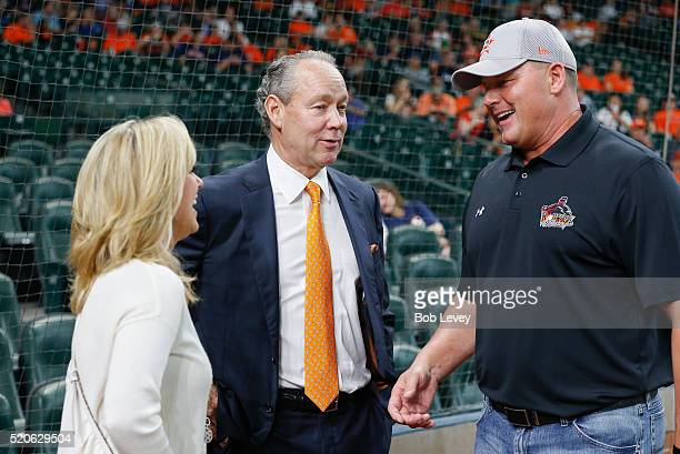 Houston Astros owner Jim Crane center talks with Roger Clemens and his wife Debbie Clemens before the Houston Astros season home opener at Minute...