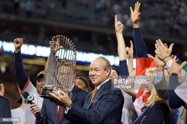 Houston Astros owner Jim Crane hoists the Commissioner's Trophy after the Astros defeated the Los Angeles Dodgers in Game 7 of the 2017 World Series...