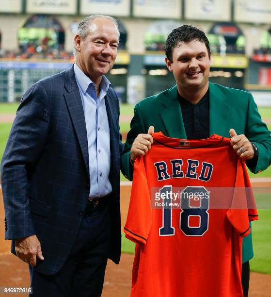 Houston Astros owner Jim Crane presents 2018 Masters champion Patrick Reed with a jersey at Minute Maid Park on April 14 2018 in Houston Texas