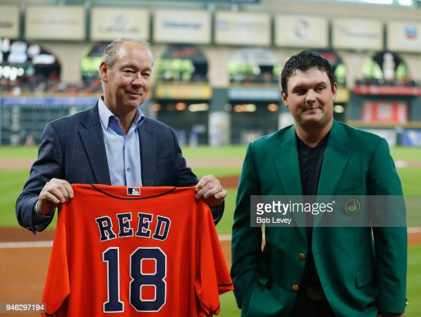 Houston Astros owner Jim Crane presents 2018 Masters winner Patrick Reed with a jersey before the game between Texas Rangers and Houston Astros at...