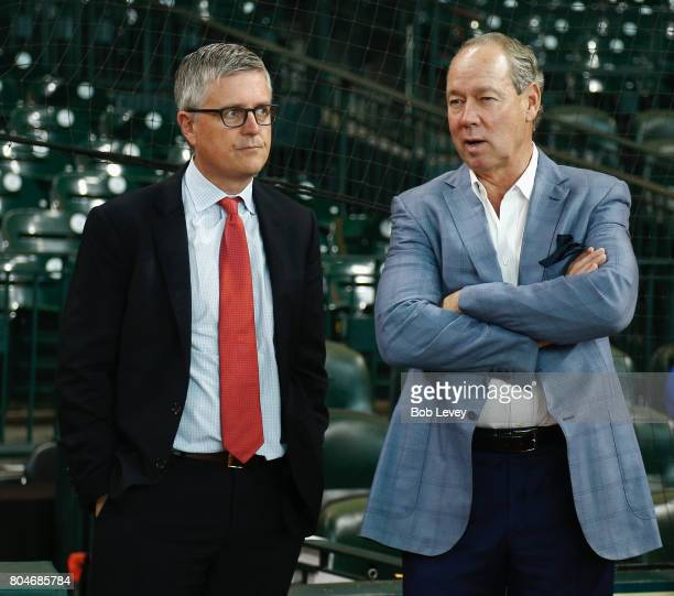 Houston Astros owner Jim Crane right and Houston general manager Jeff Luhnow chat during battting practice at Minute Maid Park on June 30 2017 in...