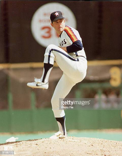 Houston Astros pitcher Nolan Ryan winds up for a pitch on the mound during a game, 1980s.
