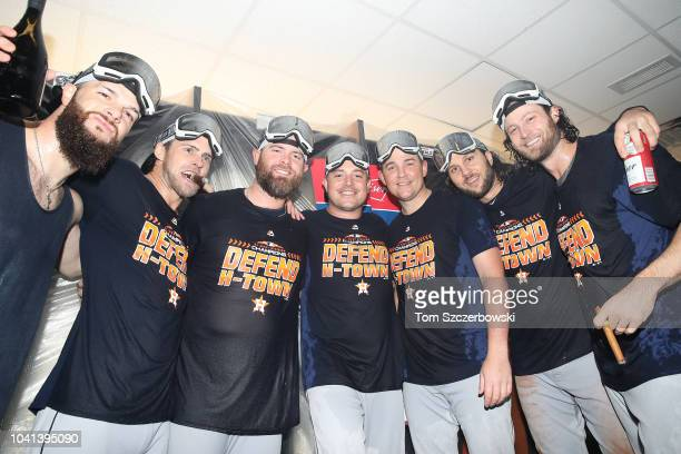 Houston Astros players celebrate in the clubhouse after the Astros clinched the American League West division title after their MLB game against the...