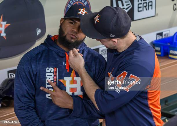 Houston Astros relief pitcher Chris Devenski pulls on the beard of Houston Astros relief pitcher Francis Martes during the MLB game between the...