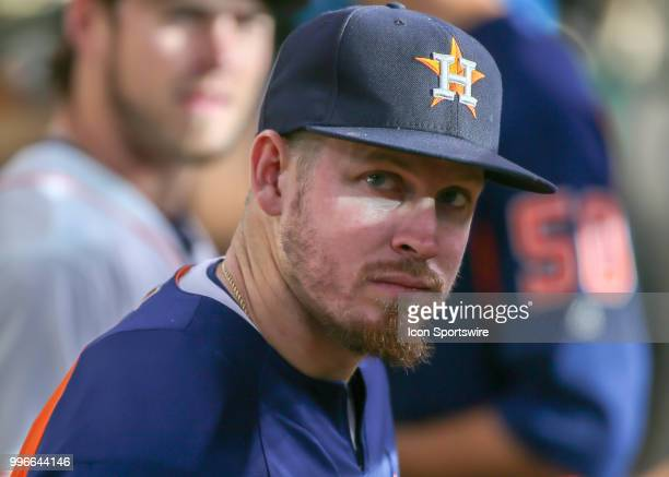 Houston Astros relief pitcher Chris Devenski relaxes in the dugout during the baseball game between the Oakland Athletics and Houston Astros on July...