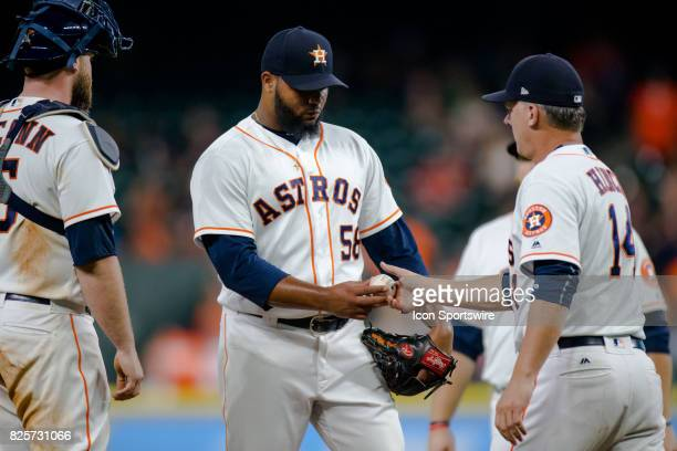 Houston Astros relief pitcher Francis Martes hands to ball over to Houston Astros manager AJ Hinch in the eighth inning of a MLB game between the...