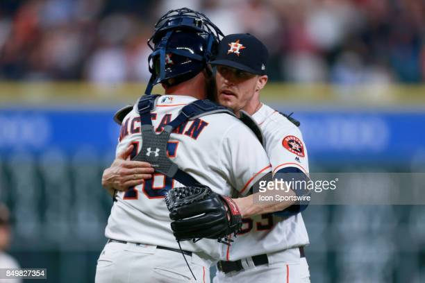 Houston Astros relief pitcher Ken Giles gives Houston Astros catcher Brian McCann a hug after defeating the Chicago White Sox after an MLB game...