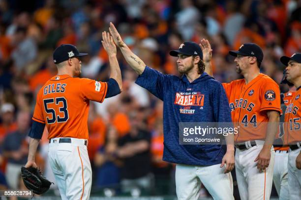 Houston Astros relief pitcher Ken Giles shakes hands with teammates after game two of American Division League Series between the Houston Astros and...