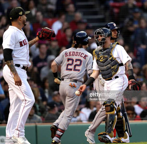 Houston Astros right fielder Josh Reddick heads to the Astros dugout after putting Houston up 2-0 on his sacrifice fly off Boston Red Sox starting...