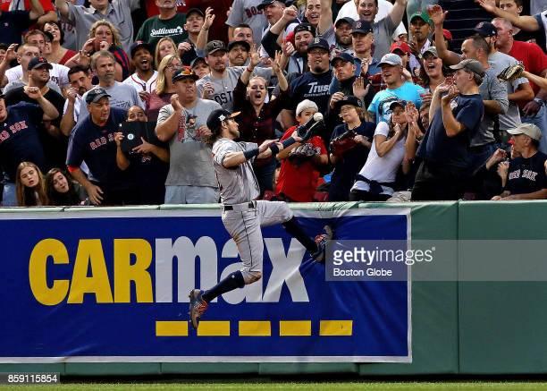 Houston Astros right fielder Josh Reddick leaps but can't make the catch on a threerun home run by Boston Red Sox center fielder Jackie Bradley Jr in...