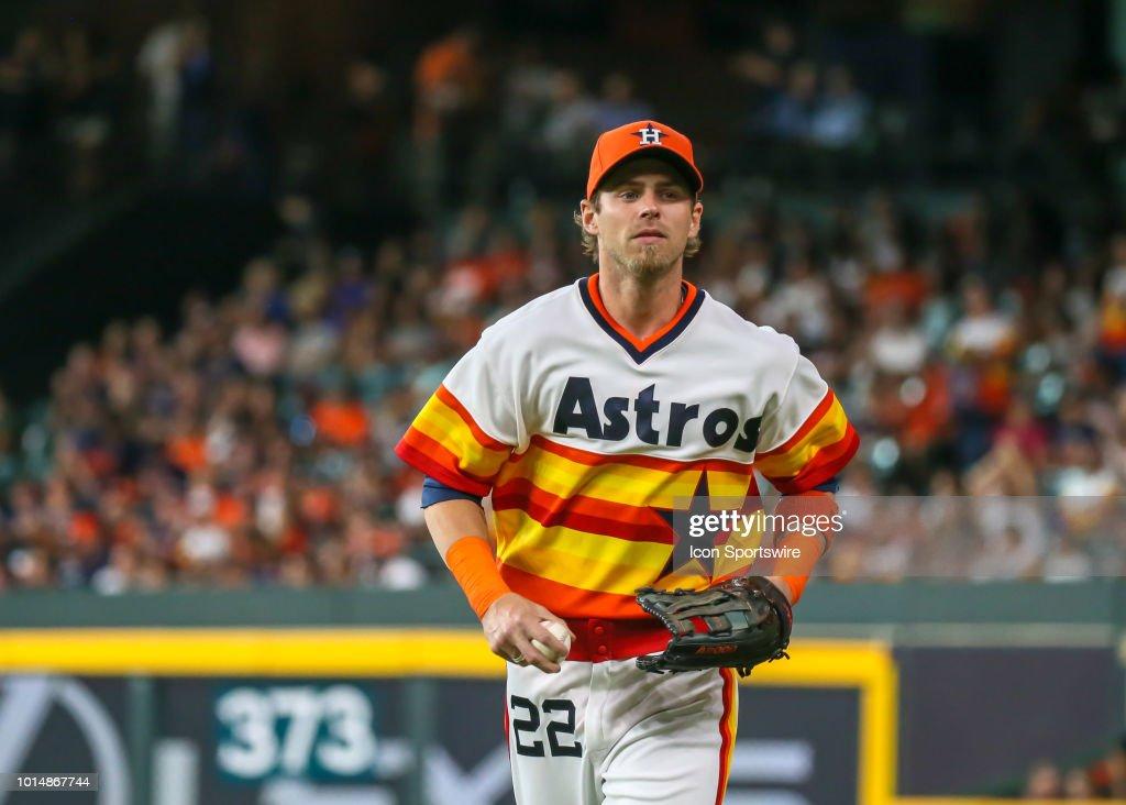 purchase cheap b76c6 d89e5 Houston Astros right fielder Josh Reddick sports a 1970s ...