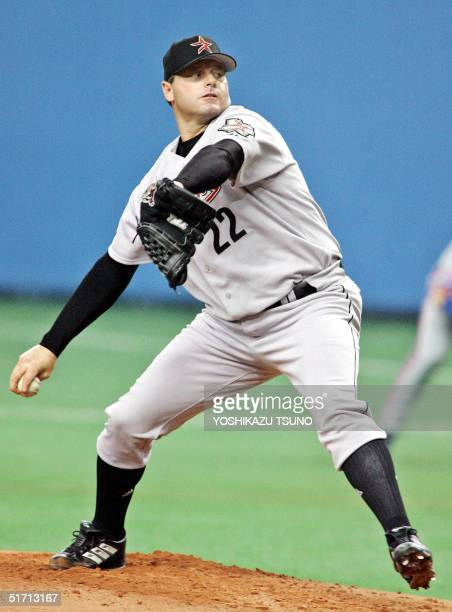 Houston Astros' Roger Clemens hurls against a Japanese butter during a friendly match between the Major League Baseball selected team and Japanese...