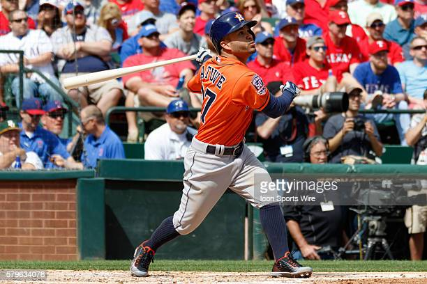 Houston Astros Second base Jose Altuve [7373] watches as he flies out to right field during the home opener between the Texas Rangers and the Houston...