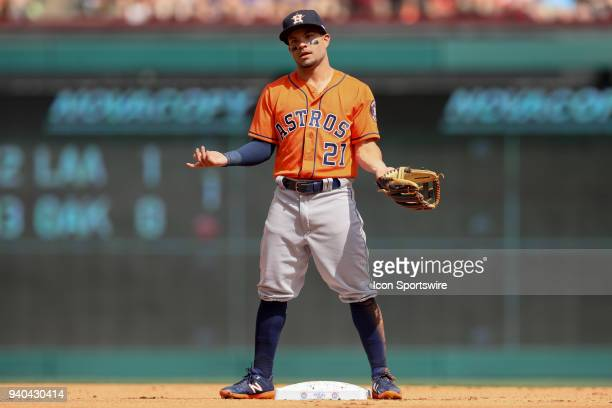Houston Astros Second base Jose Altuve gestures at his teammate during the baseball game between the Houston Astros and Texas Rangers on March 31...