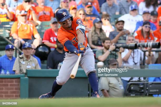 Houston Astros Second base Jose Altuve stretches to make contact during the baseball game between the Houston Astros and Texas Rangers on March 31...