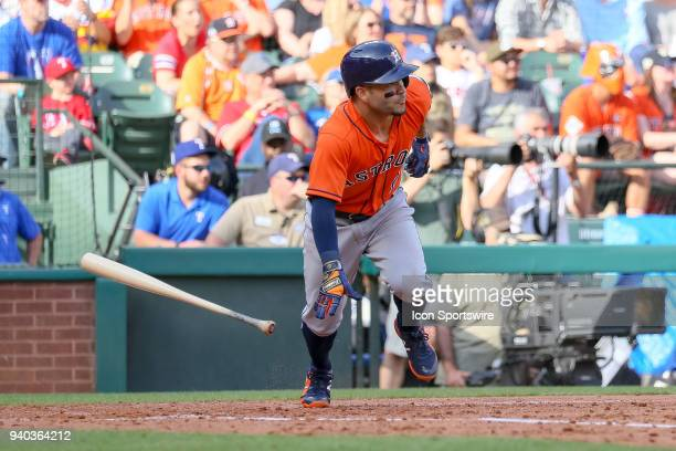 Houston Astros Second base Jose Altuve watches the ball after he makes contact during the baseball game between the Houston Astros and Texas Rangers...