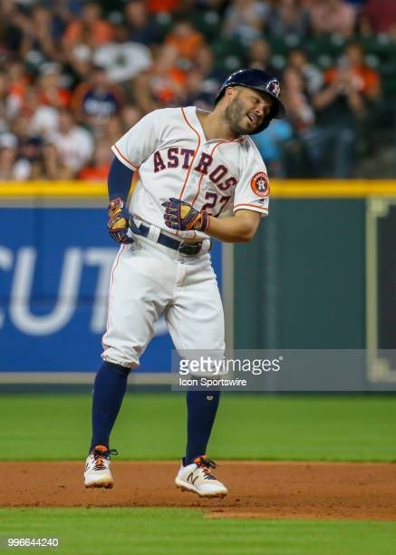 Houston Astros second baseman Jose Altuve celebrates after getting in single in the bottom of the fourth inning during the baseball game between the...