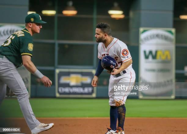 Houston Astros second baseman Jose Altuve challenges Oakland Athletics third baseman Matt Chapman after taking a slide during the baseball game...