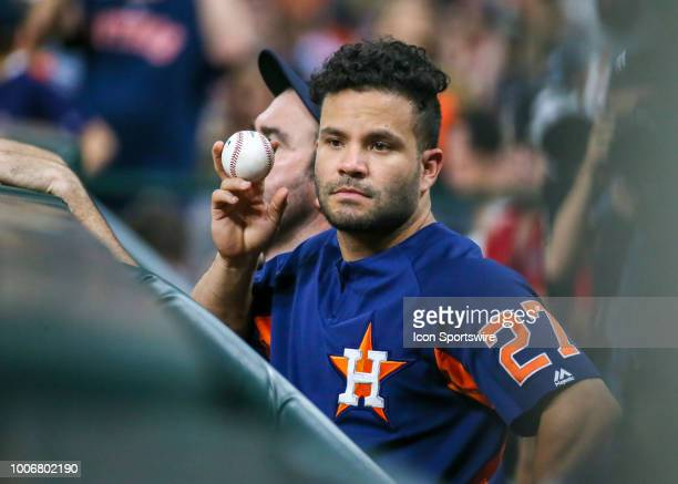 Houston Astros second baseman Jose Altuve is in the dugout nursing an injury during the baseball game between the Texas Rangers and Houston Astros on...