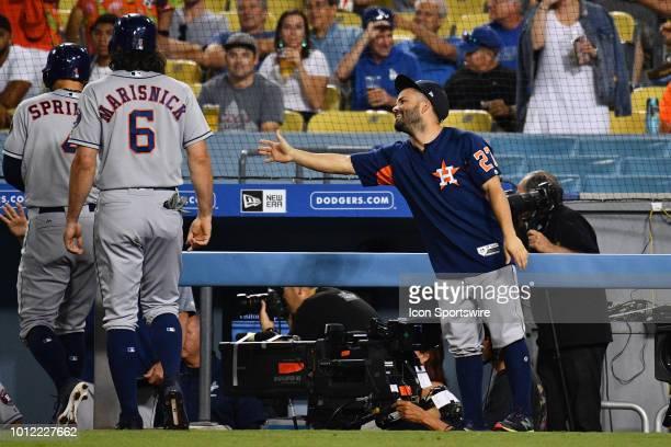 Houston Astros second baseman Jose Altuve is left hanging by Houston Astros outfielder George Springer and Houston Astros outfielder Jake Marisnick...