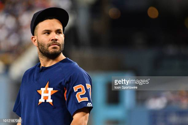 Houston Astros second baseman Jose Altuve looks on from the dugout during a MLB game between the Houston Astros and the Los Angeles Dodgers on August...
