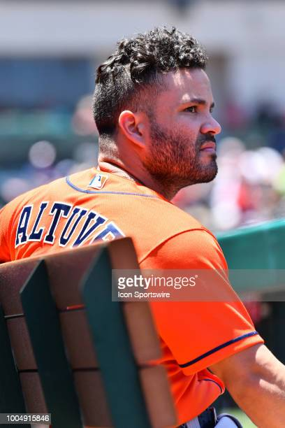 Houston Astros second baseman Jose Altuve looks on in the dugout during a MLB game between the Houston Astros and the Los Angeles Angels of Anaheim...