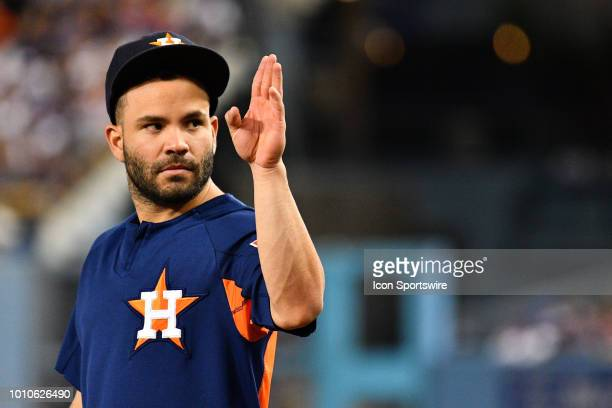 Houston Astros second baseman Jose Altuve salutes a fan during a MLB game between the Houston Astros and the Los Angeles Dodgers on August 3 2018 at...