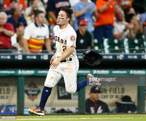 Houston Astros second baseman Jose Altuve scores in the fifth inning on a double by Carlos Correa at Minute Maid Park on May 10 2017 in Houston Texas