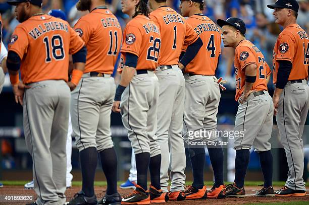 Houston Astros second baseman Jose Altuve second from right looks around during player introductions before action against the Kansas City Royals in...
