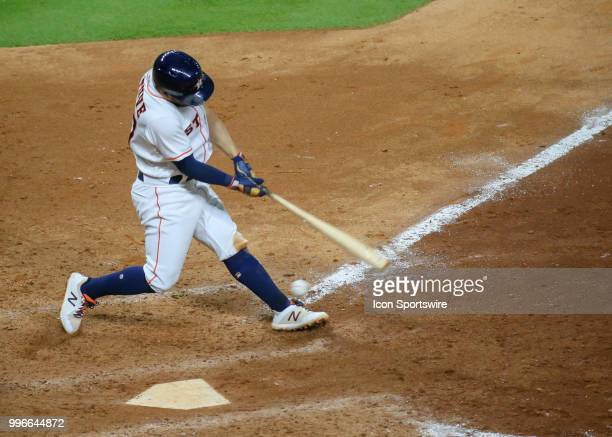 Houston Astros second baseman Jose Altuve swings and misses in the bottom of the ninth inning during the baseball game between the Oakland Athletics...