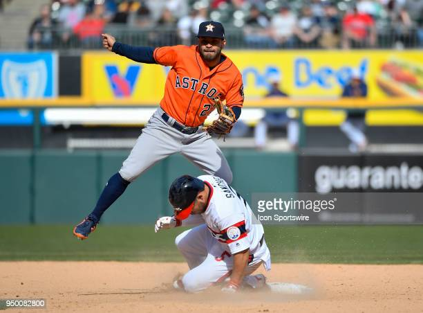 Houston Astros second baseman Jose Altuve tags out Chicago White Sox second baseman Yolmer Sanchez at second base and throws to first base to...