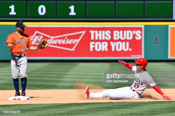 Houston Astros second baseman Jose Altuve tells Los Angeles Angels pitcher Shohei Ohtani not to slide as its a foul ball during a MLB game between...