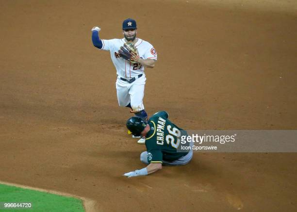 Houston Astros second baseman Jose Altuve tries to make a play at first base in the top of the seventh inning during the baseball game between the...