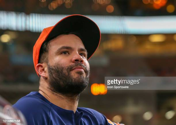 Houston Astros second baseman Jose Altuve watches from the dugout during the baseball game between the Seattle Mariners and Houston Astros on August...