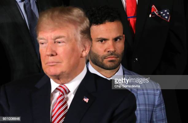 Houston Astros second baseman Jose Altuve watches US President Donald Trump during a celebration of the team's World Series victory in the East Room...