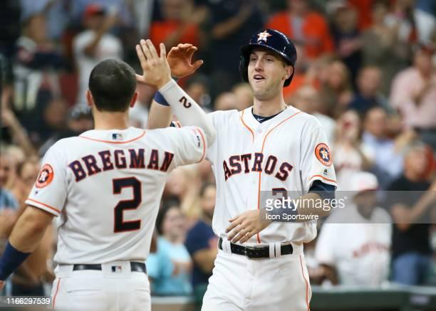 Houston Astros shortstop Alex Bregman congratulates Houston Astros right fielder Kyle Tucker on his first MLB home run during the baseball game...