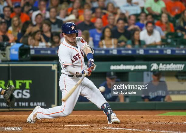 Houston Astros shortstop Alex Bregman connects with the ball during the baseball game between the Seattle Mariners and Houston Astros at Minute Maid...