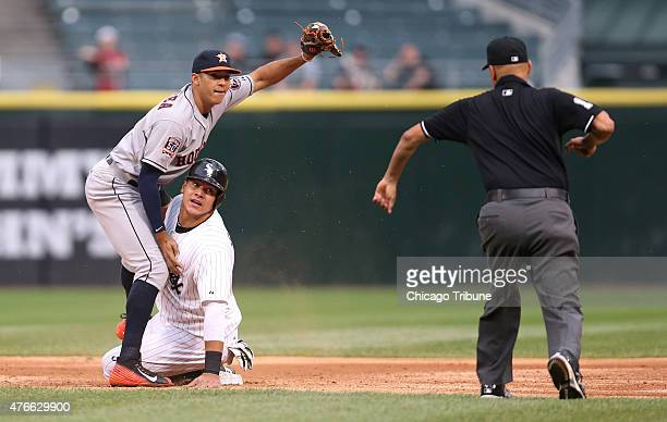 Houston Astros shortstop Carlos Correa and Chicago White Sox baserunner Avisail Garcia look to the umpire as Garcia is called out on a steal attempt...