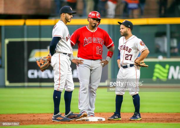 Houston Astros shortstop Carlos Correa and Houston Astros second baseman Jose Altuve chat with Los Angeles Angels catcher Martin Maldonado during the...